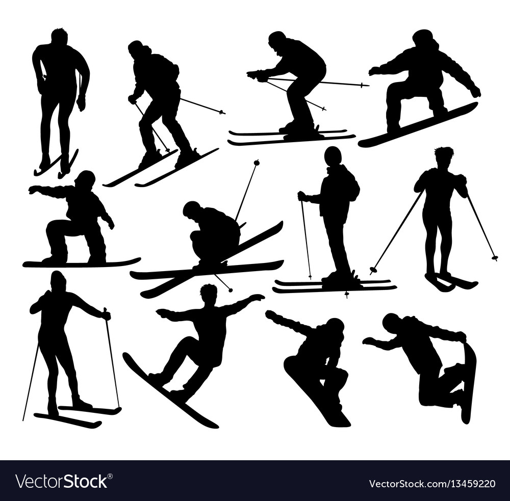 Skier standing on the snow silhouetees