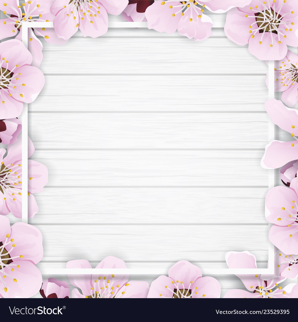 Spring frame with flowers on wooden background