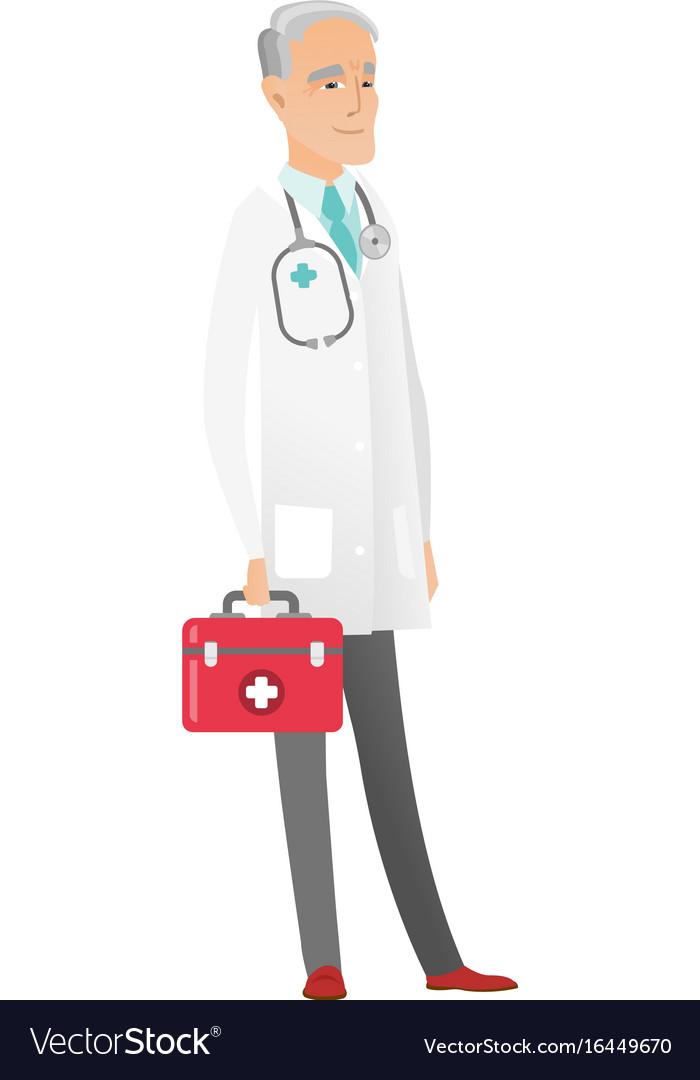 Senior caucasian doctor holding first aid box