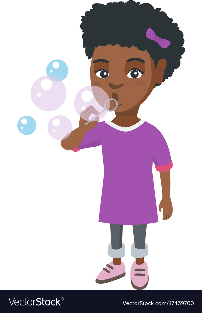 Little african-american girl blowing soap bubbles