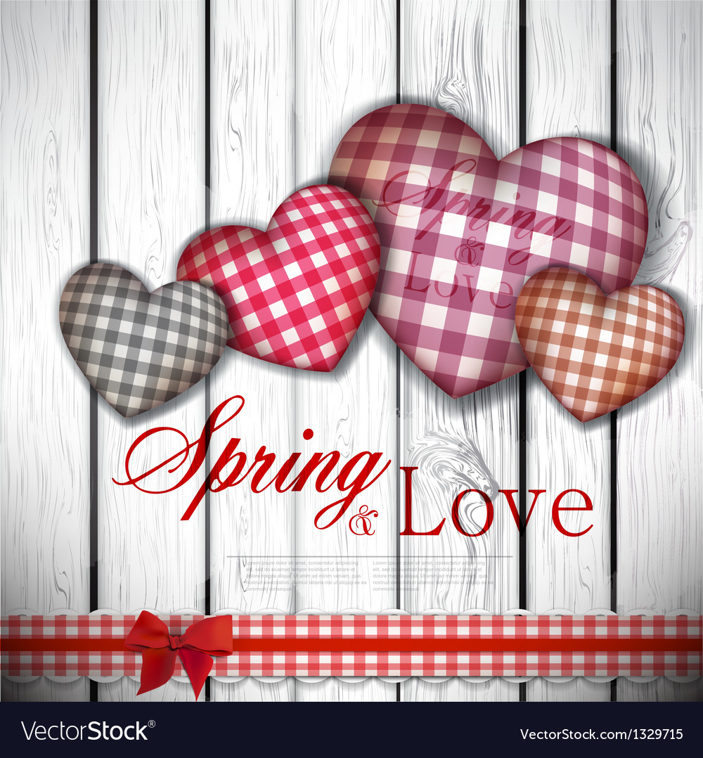 Red cloth handmade hearts on wooden background