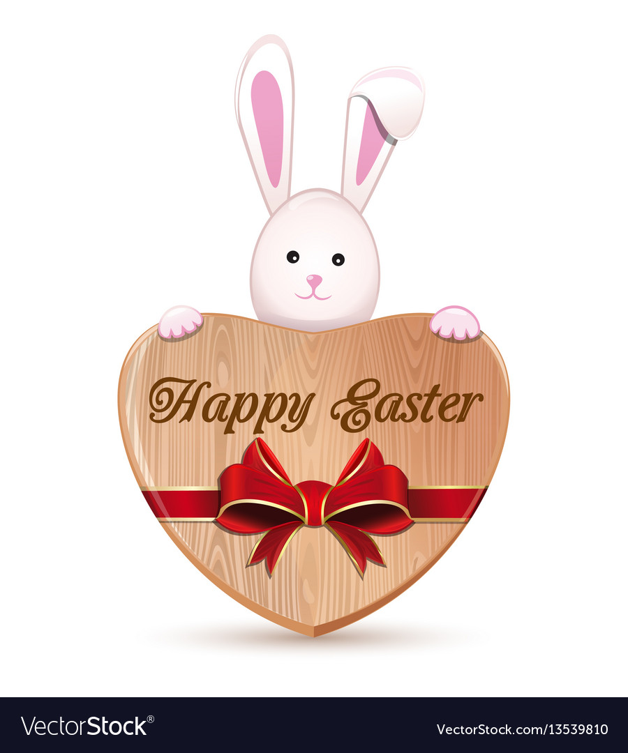Cute easter bunny holding a wooden heart with an