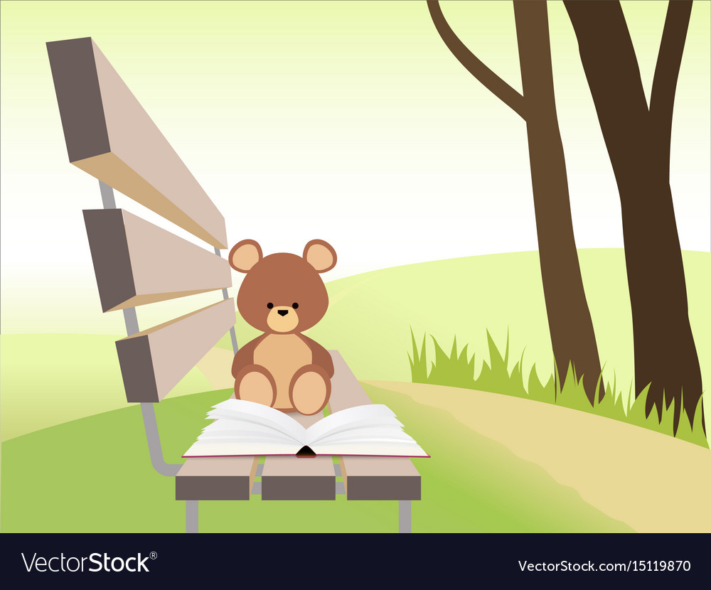Open book and bear toy on bench at sunset park