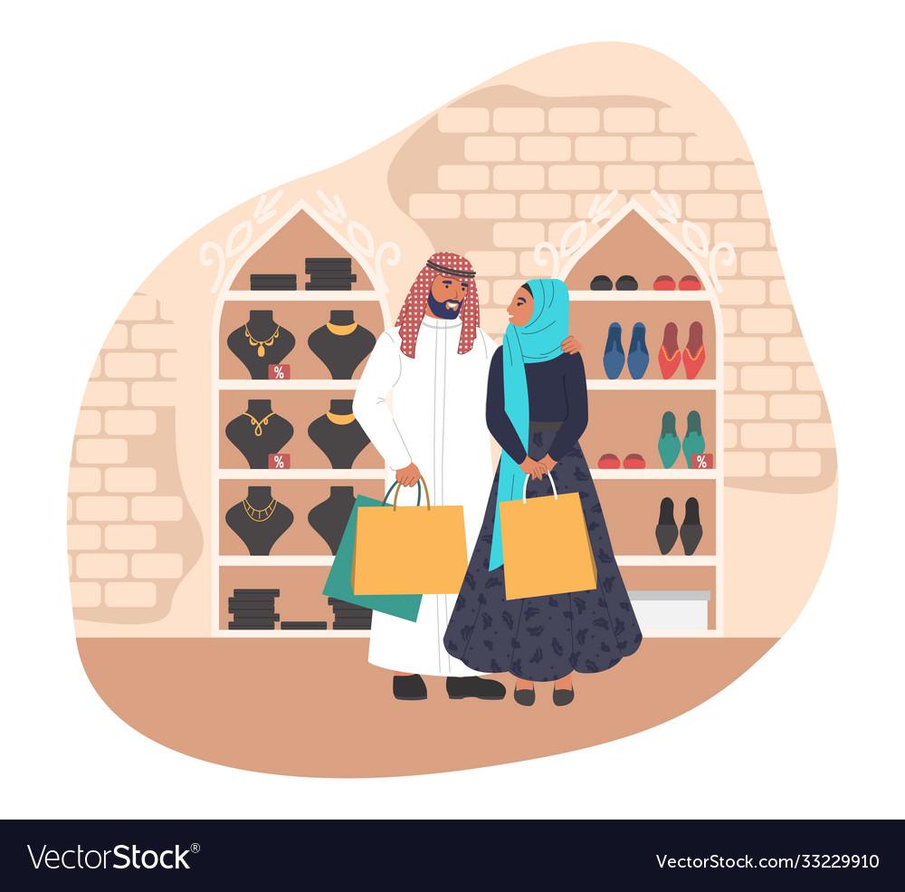 Happy muslim couple shopping in women store flat