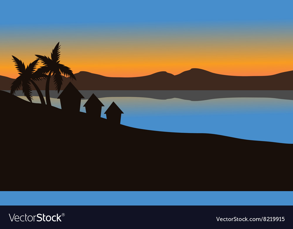 Silhouette of house on the beach