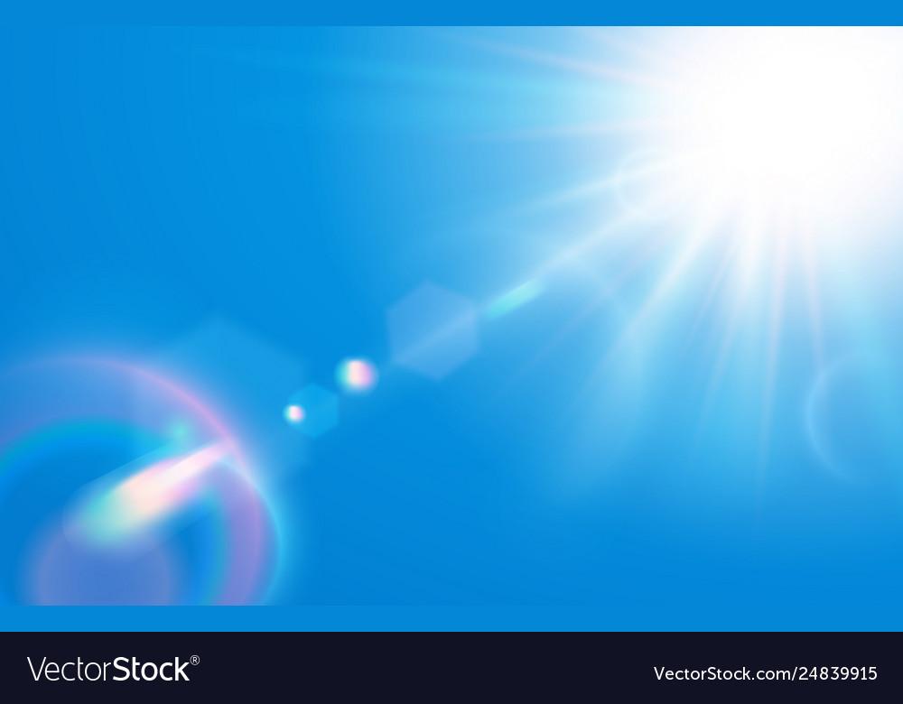 Sun in blue sky warm solar lens flare in clear