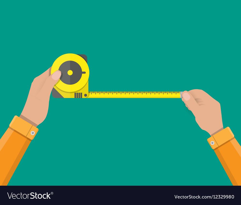 Mens hands hold measuring tape