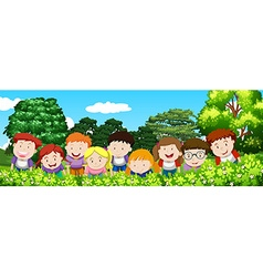 Boys and girls in the garden at daytime vector image