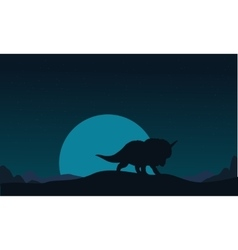 Silhouette of triceratops and big moon scenery vector image