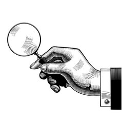 hand with an old magnifying glass vector image