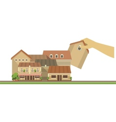 Hand puts house on the city project vector image