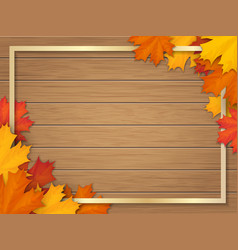 Autumn leaves and frame on wooden background vector