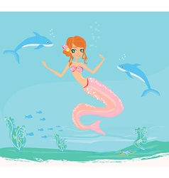a Beautiful mermaid with dolphins under water vector image vector image