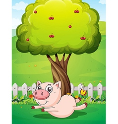 A playful pig under the cherry tree vector