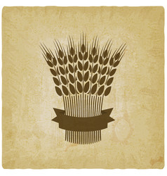 Sheaf wheat with ribbon vintage background vector
