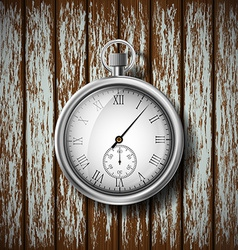 Pocket watch lying on a wooden surface vector