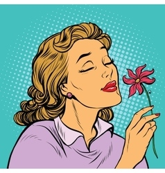 Beautiful woman inhaling fragrance of a flower vector image vector image