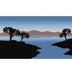 Silhouette of lake and trees vector image