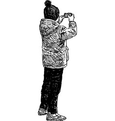 Sketch a kid photographing on his mobile phone vector