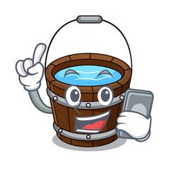 With phone wooden bucket character cartoon vector