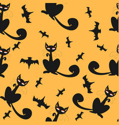 seamless pattern of halloween cats and bats in vector image
