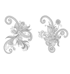 Two intricate swirling floral elements vector image
