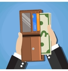 human putting cash dollars into opened wallet vector image