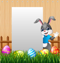 easter bunny waving hand with blank sign vector image