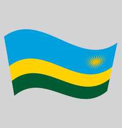 Flag of rwanda waving on gray background vector