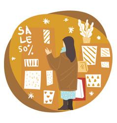 woman choosing greeting card for christmas holiday vector image