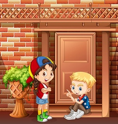 Boy and girl hanging out in front of the house vector image