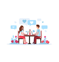 couple sitting at table using laptop happy vector image