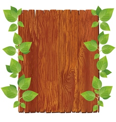Wooden board with green leaves vector image vector image