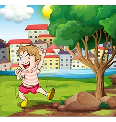 A happy kid near the tree at the riverbank beside vector
