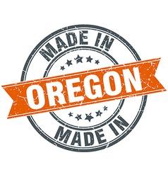 Oregon orange grunge ribbon stamp on white vector