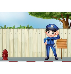 A police officer beside an empty wooden signage vector image