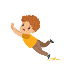 boy slipping on a banana peel vector image