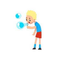 cute blonde little boy blowing soap bubbles vector image