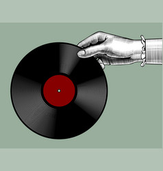 Womans hand with a gramophone record vector