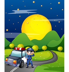 A policeman with a police car at the road vector image