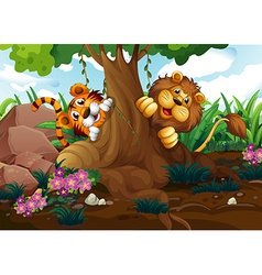 A tiger and a lion playing at the forest vector image vector image
