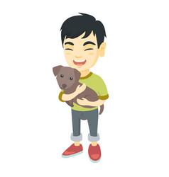 asian happy boy holding a do vector image