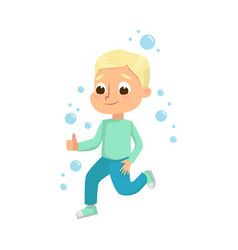 Cute little blonde boy playing with soap bubbles vector