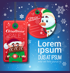 christmas sale tags on blue snowflakes background vector image
