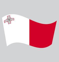 Flag of malta waving on gray background vector