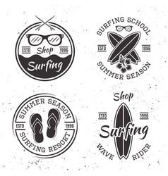 set four vintage surfing emblems and badges vector image