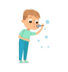 Cute boy blowing soap bubbles through wand vector