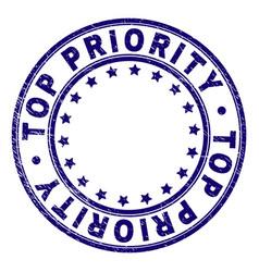 Grunge textured top priority round stamp seal vector