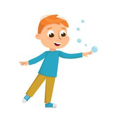 Cute boy blowing soap bubbles through wand kids vector