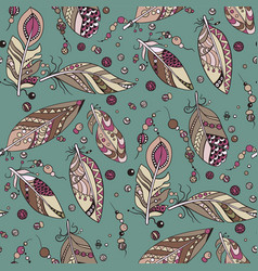 seamless tribal pattern with feathers and beads vector image